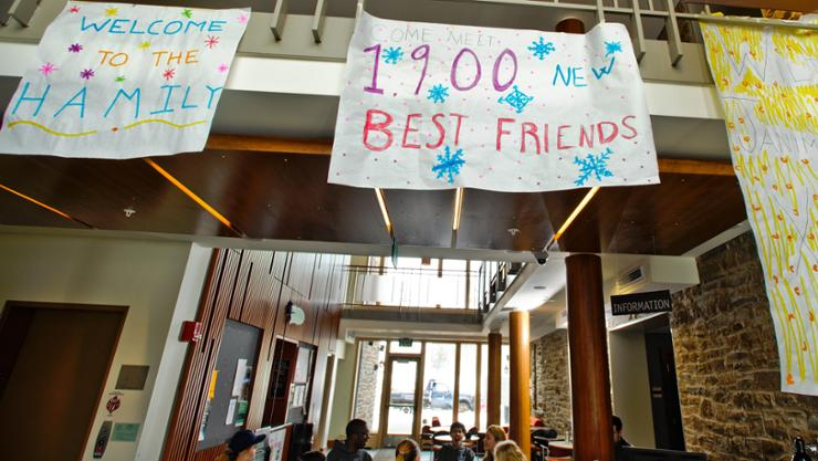 Large banners greet incoming January admits at the registration desk in the Sadove Student Center.