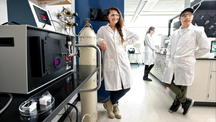 Aida Shadrav '17, left, Aaron Oh '18, right, and Willa Mihalyi-Koch '19, back center, wait for a plasma cleaner to do its work in Professor Farah Dawood's lab.