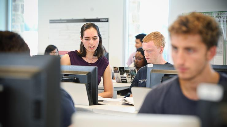 Maya Montgomery '18 helps students as she works as a TA in a computer science course taught by Alistair Campbell in the Taylor Science Center.
