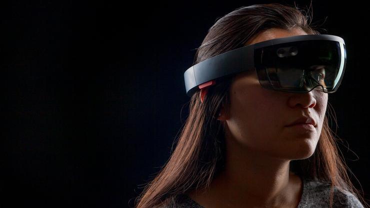 "Judy Zhou '19 sports a virtual reality headset to experience her ""empathy walk."""
