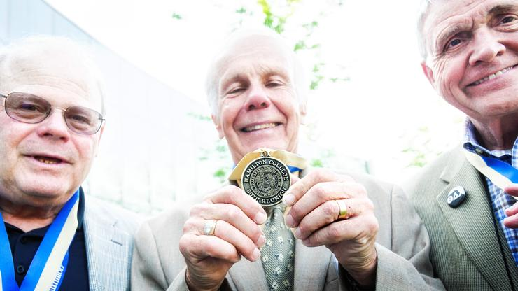 Members of the Class of 1968 show off their Half-Century Club medallions.