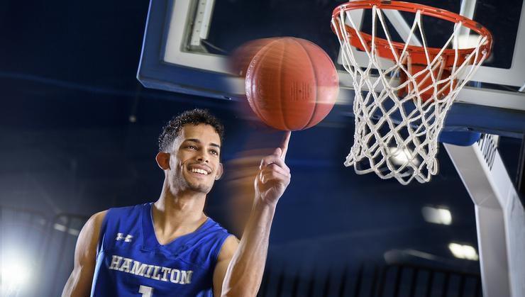 Men's basketball star Kena Gilmour '20 on the court in November.