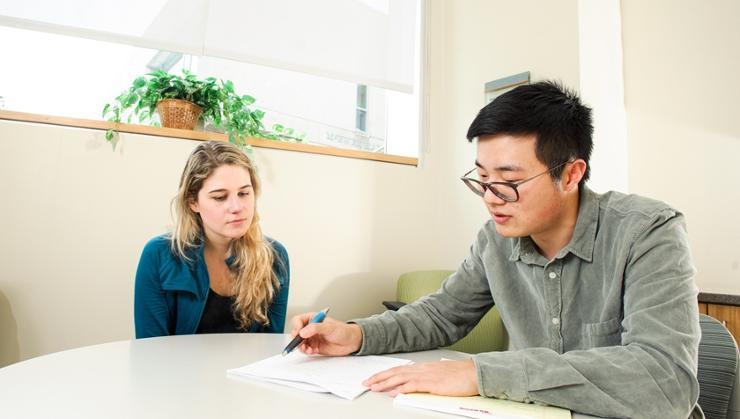 Bryce Fan '20 tutors GiGi de Hechavarria '21 in the Writing Center.