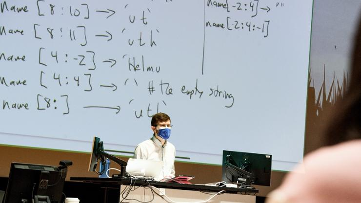 Tom Helmuth '09 teaches his computer science intro class in Wellin Hall.