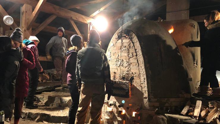 Students in the Adirondack Program prepare for firing the kiln at Craigardan.