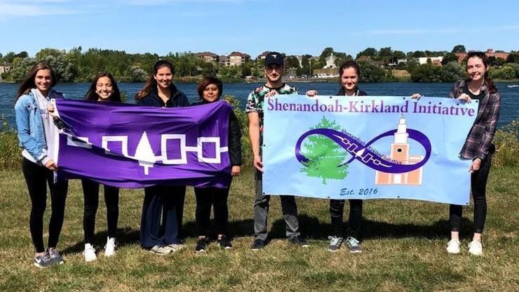 Akwesasne Powwow banners held by Shenandoah-Kirkland Initiative members (L-R) Amanda Johnson, Colonie Gray, Anne Parnell, Juana Palafox, David Gagnidze, Aoife Thomas, and Ellie Williams