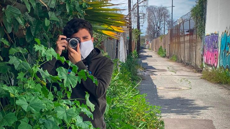 Alex Medina '22 working on a news story in East L.A.