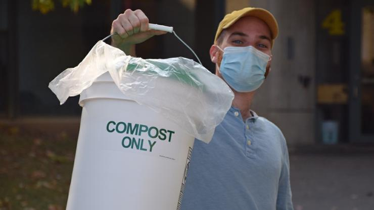 Andrew Little '21 with collected food scraps from Babbitt.