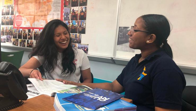 Anyi Rescalvo '22 (left), a participant in the Joan Hinde Stewart (JHS) Career Development Program, works with a student on college exploration.
