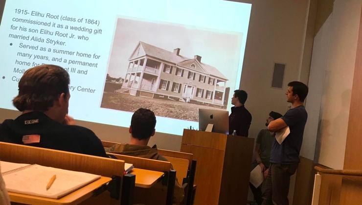Seniors Nick Balderston, Alec Neal, and Andrej Bogdanovics presenting their midterm project report on the Molly Root House.