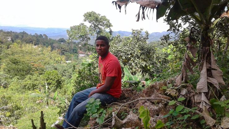 Arthur Williams '16 on a farm in rural Jamaica.