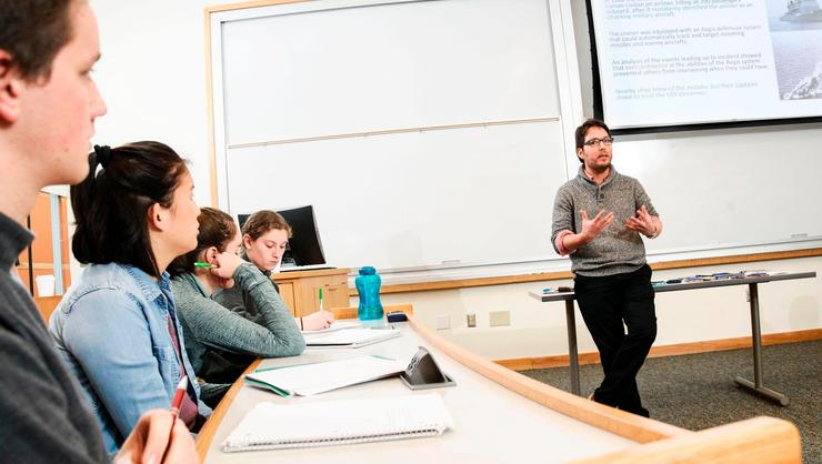 Visiting Assistant Professor of Philosophy Manuel Barrantes talks to students in his Ethical and Social Issues in the Digital Age class.