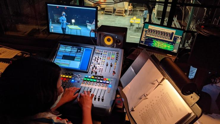 Sound assistant Olivia Batal '23 works at a mixing console during the Spring Theatre production <em>The Last Days of Judas Iscariot</em>.
