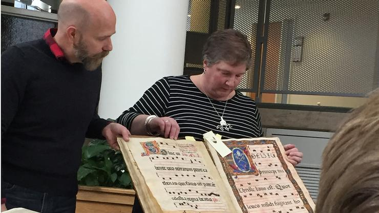 LITS staff members Mark Tillson and Kristin Strohmeyer show items from Hamilton's Special Collections.