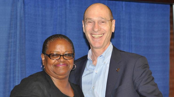 Phyllis Breland '80 receives congratulations from President David Wippman as recipient of the EllieWertimer– PatsyCouperAward.