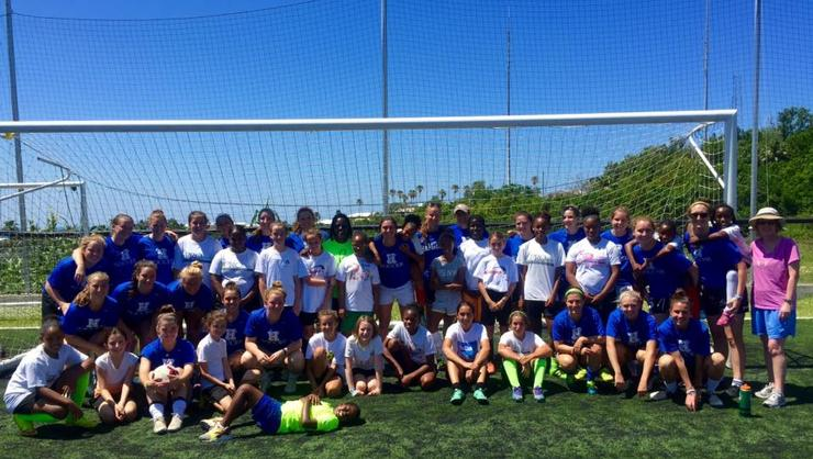 Hamilton's women's soccer team with youth players at a clinic in Bermuda.