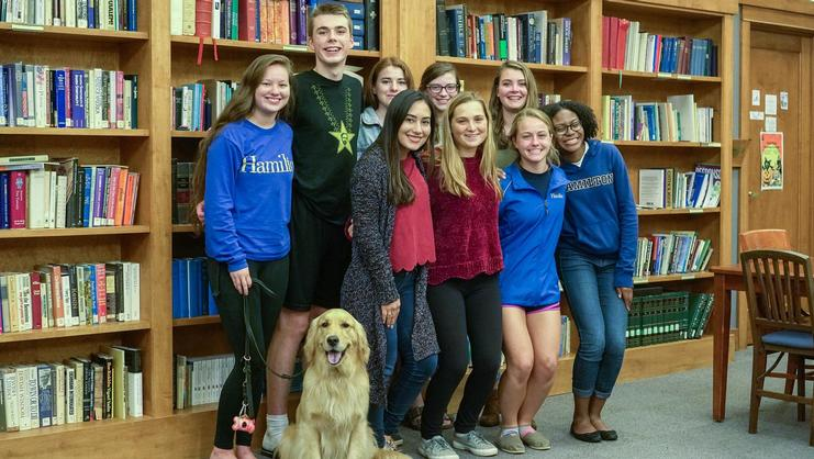2017 COOP Service Interns. Front: Percy the dog, Diana Perez, Amy Harff, Avery Cook, Savannah Kelly. Back: Claire Nakazawa, Jack Scacco, Adriana Mullin, Juliana DeSimone, Claire McCaslin.