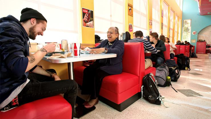 Henry Johnstone '17 and Professor Shelley Haley eat lunch in the Diner.