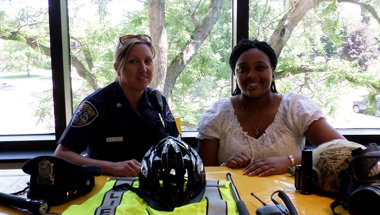 Alessandria Dey '15, right, with Rochester police officer Michelle Velez.