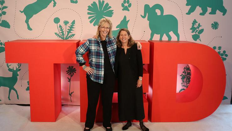 Professor Katheryn Doran, right, at the TEDSummit with Lynn Womble, director of public affairs for Austin College.