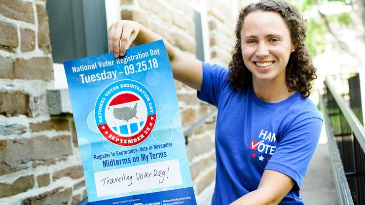HamVotes chair Nicole Taylor '19 holds a poster advertising National Voter Registration Day.