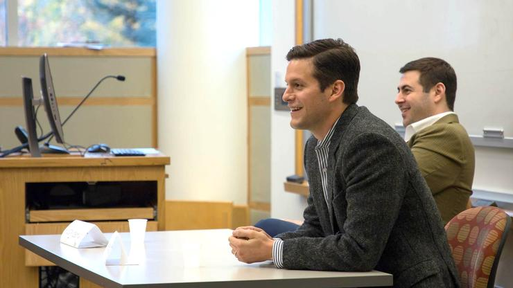 Kevin St. John '06, (foreground) and Andy Berman, '06, right, met with students to discuss careers at Facebook.