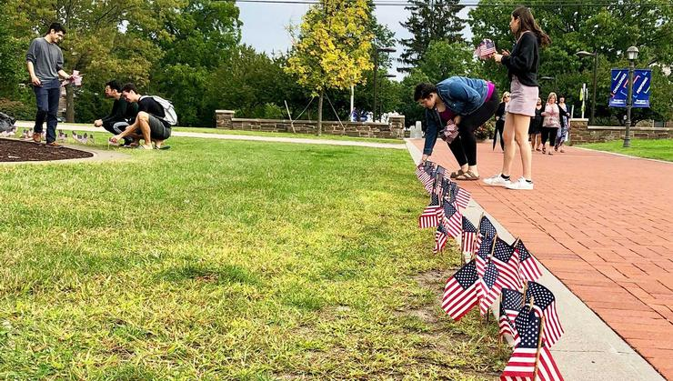 Members of the Hamilton College Democrats and Hamilton College Republicans place flags outside Sadove on Sept. 11.