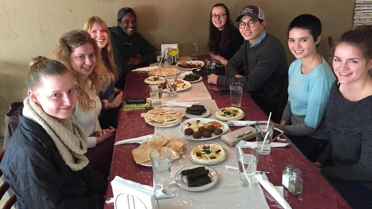 Students of College 236: Culture and Politics of Food enjoy a meal at Hummus and Tabbouleh, a Middle Eastern restaurant in Utica.