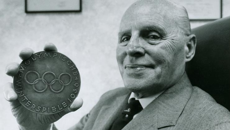 Francis Baker '36 shows off his medal.
