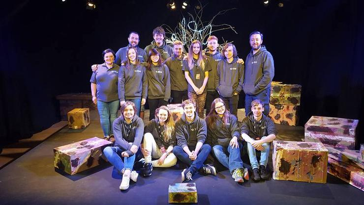 Frankie Outlaw '18, seated, fourth from left, on stage at the Edinburgh Festival Fringe with Royal Welsh students and faculty she worked with during an internship.