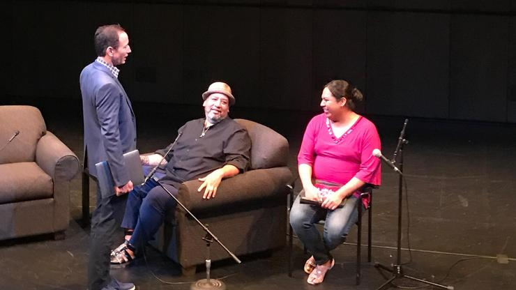 Jeffrey Gibson, seated at center, and Macy, a member of the Choctaw Nation (right) who is featured in Gibson's <em>I Was Here</em> spoke about Gibson's exhibit at the Wellin Museum.
