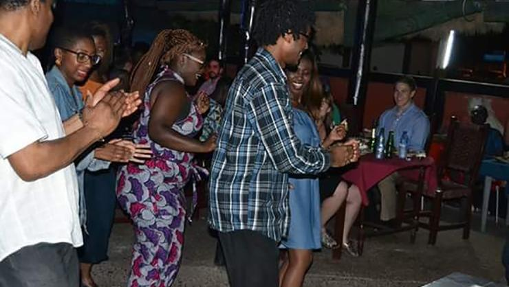 From left, Rayyon Robinson, Sarayah Wright, Akua Sefa, Sacharja Cunningham '19 and Bernice Appiah at Chez Afrique restaurant, dancing after a meal.