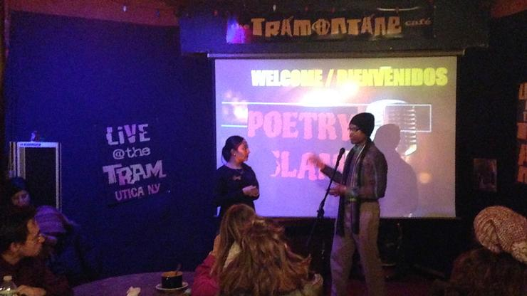 Seniors Shaina Coronel and Sacharja Cunningham introduce a Hispanic Studies poetry slam at the Tramontane Cafe in Utica, N.Y.