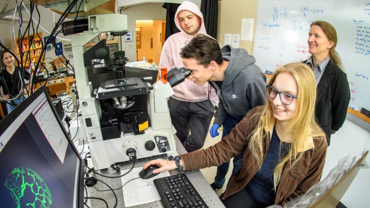 Assistant Professor of Physics Viva Horowitz works with Clare Nele '24, Trevor Scheuing '23, and Matt Jankowski '22 on a project to build and investigate the dynamics of a simple artificial cell in their lab.