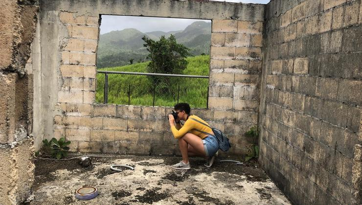 Shelby Castillo '19 in Rio Grande, Puerto Rico, in a building ravaged by Hurricane Maria.