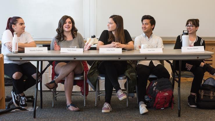 Natasha Espinosa '18, far left, and student panelists discuss their communications internships.