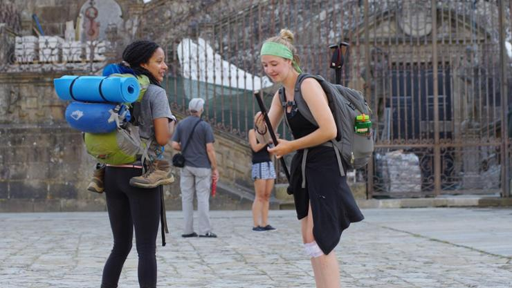 Estella Brenneman '20, right, with a friend she made en route, at her final destination — Santiago de Compostela in Spain, at a cathedral.