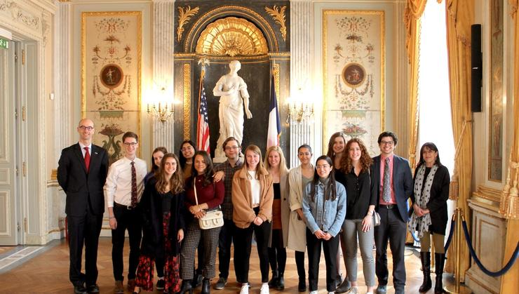 Hamilton in France students with James Du Vernay '03 at the U.S. Embassy's George C. Marshall Center, known as the Hôtel de Talleyrand.