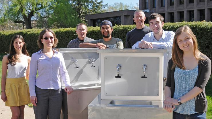 Jen Kleindienst '09, front left, in sunglasses, with a student-designed water wagon at Wesleyan University