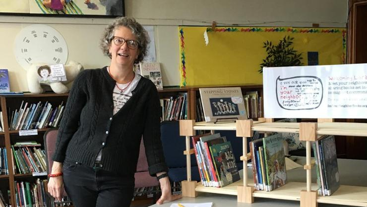 Kate Cutko '85 and the traveling library she created.