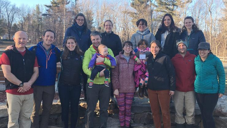 Front row, from left: Andrew Jillings, Jack Messerly '14, Izzy Janzen '14, Ben Oliver '02 (with son Finn), Maggie Horne '19, Jess Anderson '02, Devin Farkas '10, and Anna Bastidas '13. Back row, from left: Abby Kaplan '19, Janine Oliver, Sarah Jillings (with daughter Hadley), Amber Aparicio '18, and Megan Bates '18.