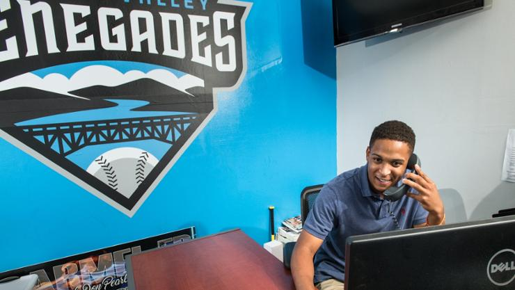 Justin Leigh '20 works the phones at Dutchess Stadium where he did a summer internship with the Hudson Valley Renegades
