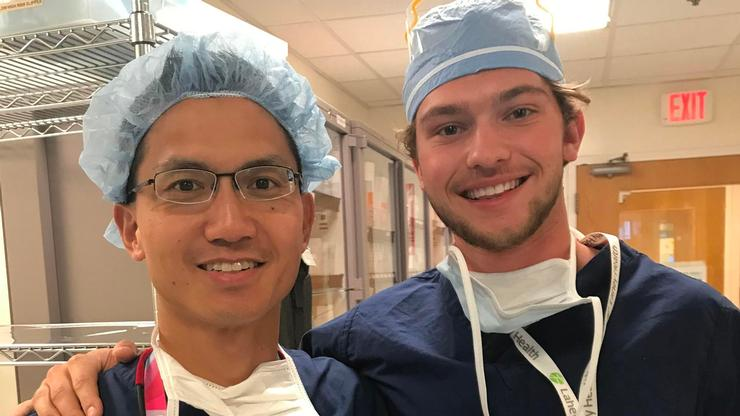 Gabe Linden '20, right, and Dr. Maximillian Soong, a hand surgeon, minutes before entering the OR.