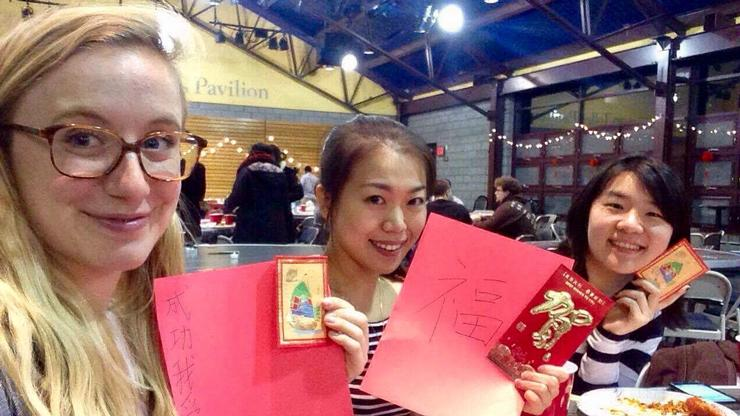 French Teaching Fellow Morgane Gillou, Chinese Teaching Fellow Huili Zhang, Teaching Fellow in East Asian Languages and Literature Yu-Ping Tai display their wishes at the Lunar New Year celebration.