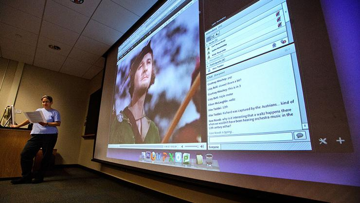 Music professor Lydia Hamessley teaches an online music class to alumni in 2013.