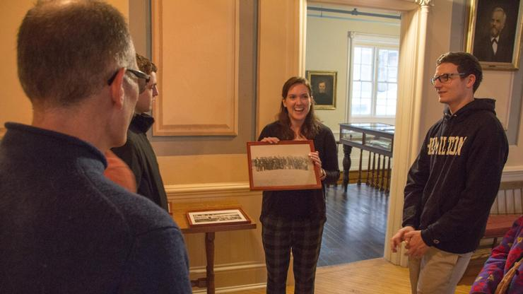 Mansion House tour guide Molly Jessup describes a photo to the group.