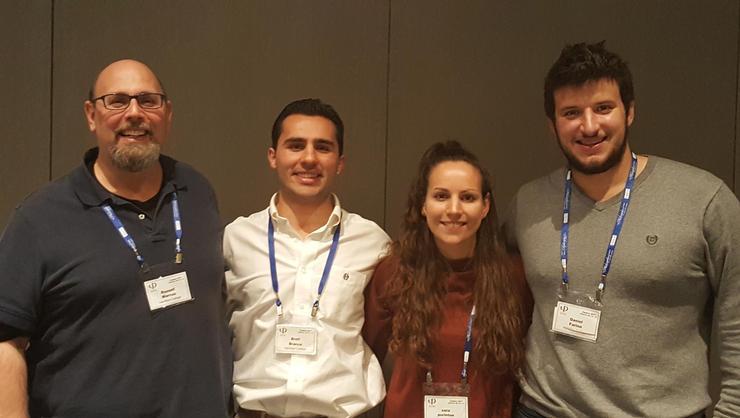 From left: Professor Russell Marcus with seniors Brett Bracco, Sara Purinton and Dan Farina at the APA meeting in Washington, D.C.