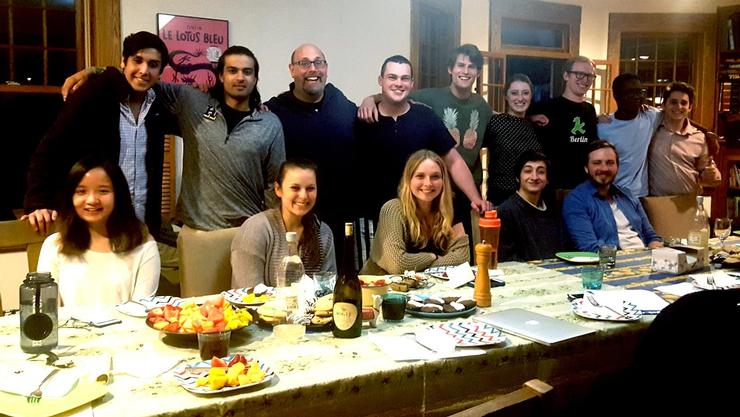 Photo from Engaged Philosophy article: Marcus with students at a dinner in his home