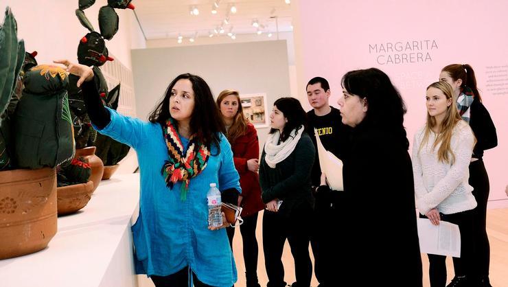 Artist Margarita Cabrera, left, explains her work to Luisa Briones-Manzano's class at the Wellin Museum.