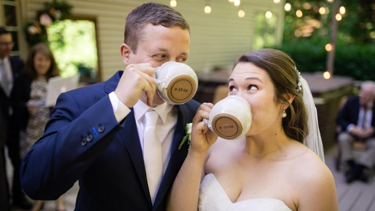 Eli and Marian Burgard '16 with Clinton Pottery mugs that bear their wedding date.